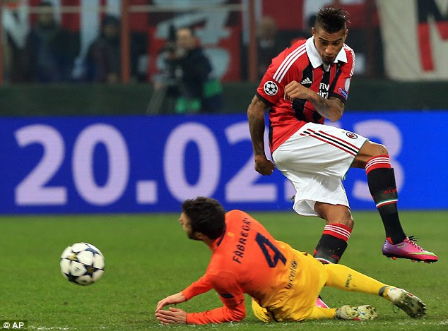 Head to head: Cesc Fabregas, is fouled by Boateng