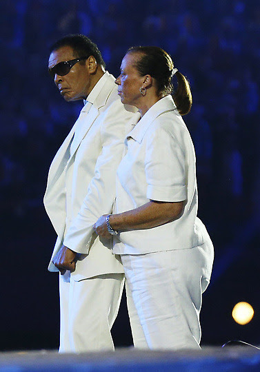 Boxer Muhammad Ali, left, and his wife, Yolonda Williams, participate in the Opening Ceremony at the 2012 Summer Olympics, Saturday, July 28, 2012, in London. (AP Photo/Cameron Spencer, Pool)