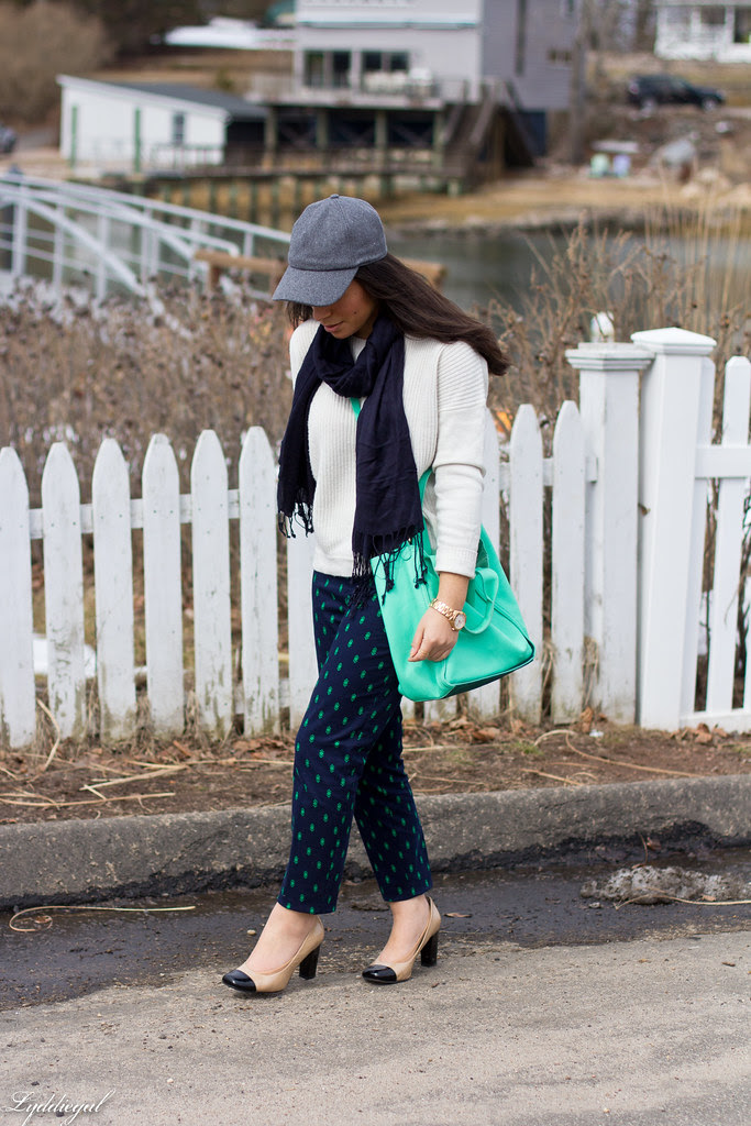 printed pants, white sweater, baseball cap.jpg