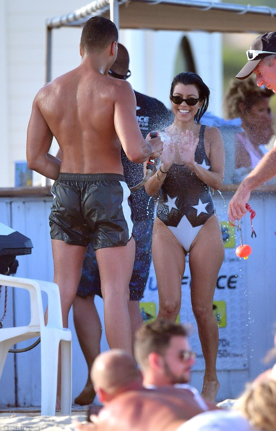 Cooling off: Kourtney Kardashian was hosed off by her boytoy Younes Bendjima during their holiday in St Tropez