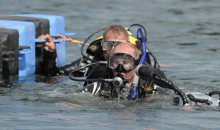 Vladimir Putin prepares to dive during a visit to the excavation site of the ancient Greek port on the Taman Peninsula, about 1,150 kilometers south of Moscow, Russia, August 10, 2011.  Ancient Greek colonies, which were on the peninsula, served as centers of trade with the steppe peoples on the territory of today's Ukraine and Russia.