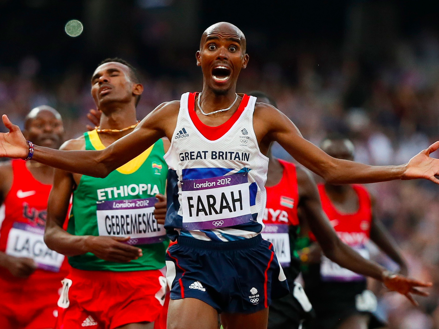 Britain's Mo Farah reacts as he wins the men's 5000m final at the London 2012 Olympic Games at the Olympic Stadium August 11, 2012.