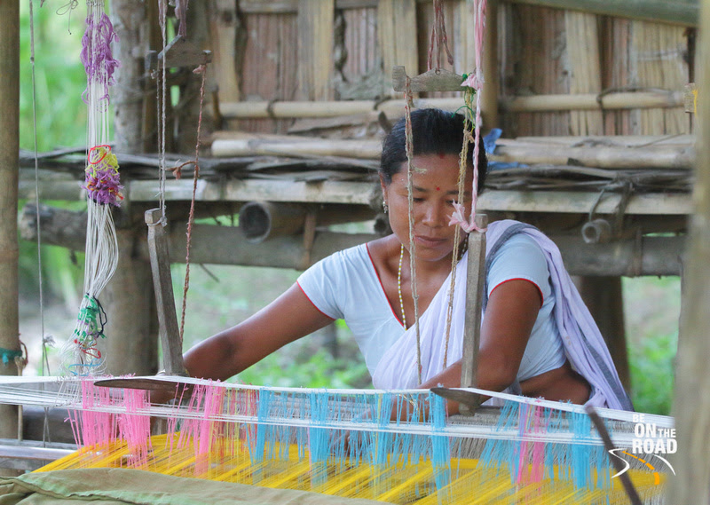 Portrait of Mishing tribal woman weaving on her traditional loom, Panbari village, Assam