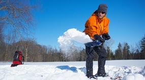 Photo: A man shoveling snow