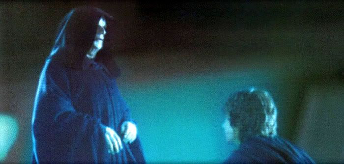Anakin being congratulated by Darth Sidious after the Jedi slaughter.