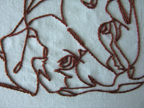 Detail of stitching and the dog eye...