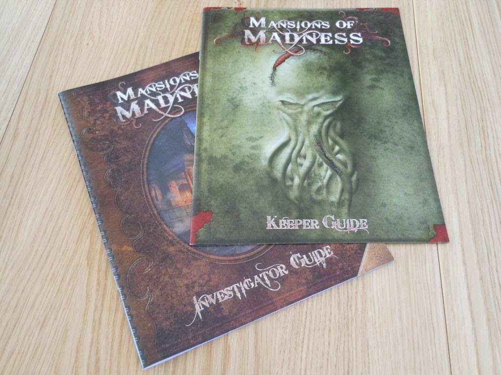 The two rules books included with Mansions of Madness. One contains information for the heroes, while the second contains dark secrets.