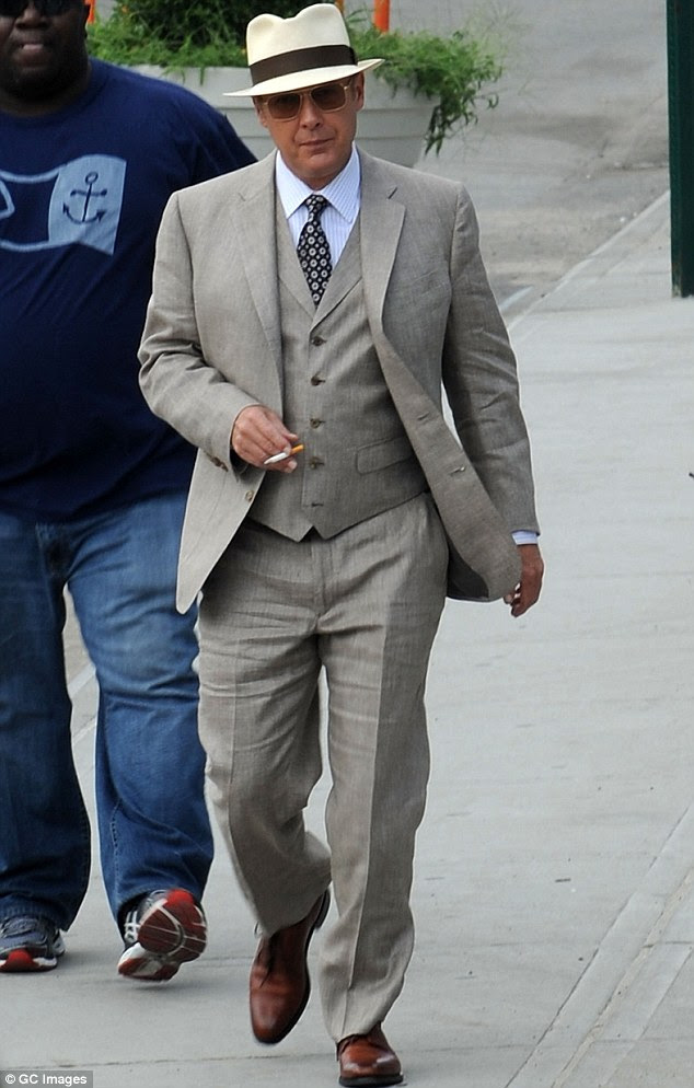 So dapper: James Spader strolls around the Brooklyn set of The Blacklist in New York City on Thursday looking smart in a three piece suit and straw hat
