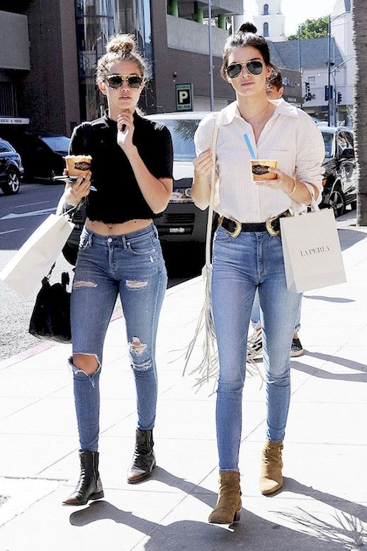 Le Fashion Blog Model Style Kendall Jenner Gigi Hadid Messy Top Knot Sunglasses Black Crop Top White Button Down Shirt Shoulder Bag Jeans Western Inspired Ankle Boots Via Who What Wear