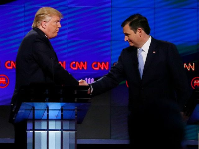 Donald Trump (L) shakes hands with Texas Senator Ted Cruz (R) following the CNN Republican Presidential Debate March 10, 2016 in Miami, Florida.