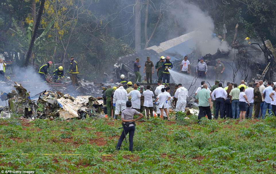 Fire crews and emergency services were on the scene to put out the fire still smoldering in the ashes of the plane