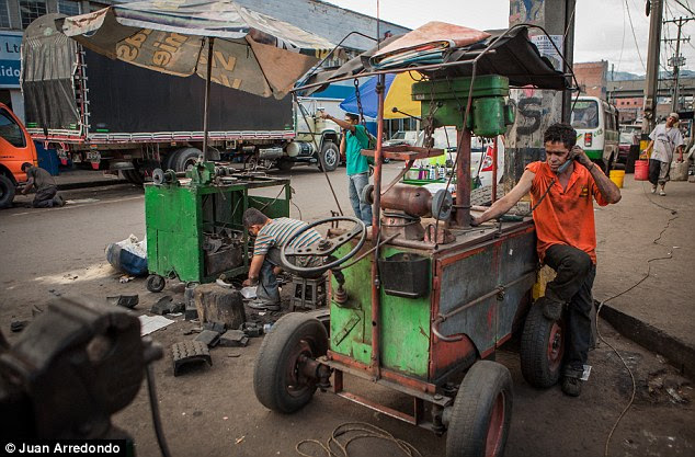 Grime: Workers repair vending carts on the street