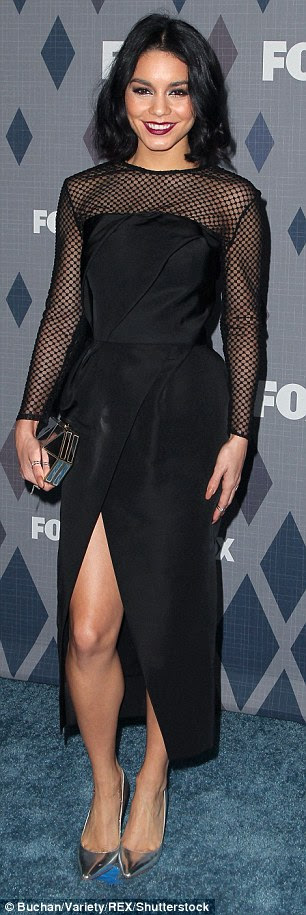 Oh la la: Vanessa opted for the sexier dress, stepping out in a silk black dress with sheer netting sleeves