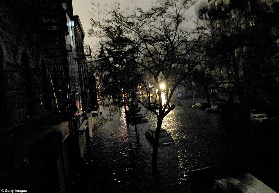 Torrent: Cars on Avenue C and 7th Street are submerged in floodwater which flowed through the city after Superstorm Sandy arrived