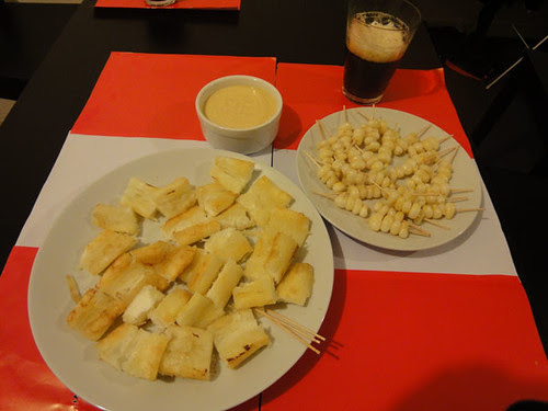 Yuquitas fritas, huancaina sauce, choclito, malt beer