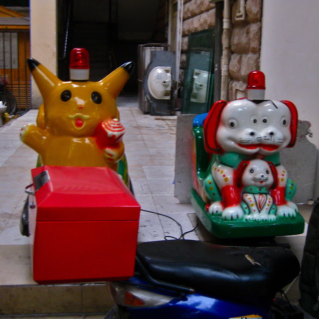 Coin-operated kiddie rides, featuring Pikachu and a two-headed dog, Chengdu