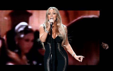 Mariah Carey performs at the AIDS Healthcare Foundation (AHF) 30th Anniversary Celebration and World AIDS Day concert featuring DJ Khaled and Ne-Yo at The Shrine Auditorium on November 30, 2017 in Los Angeles, California. (Photo: Business Wire)