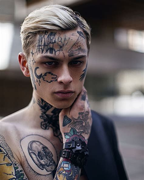 cool face tattoo young boy model atlaviedekirill