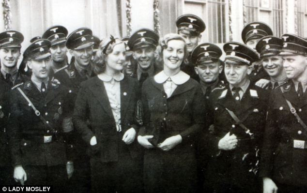 Unity Mitford (left), pictured with her sister Diana Mitford and members of the Nazi Party