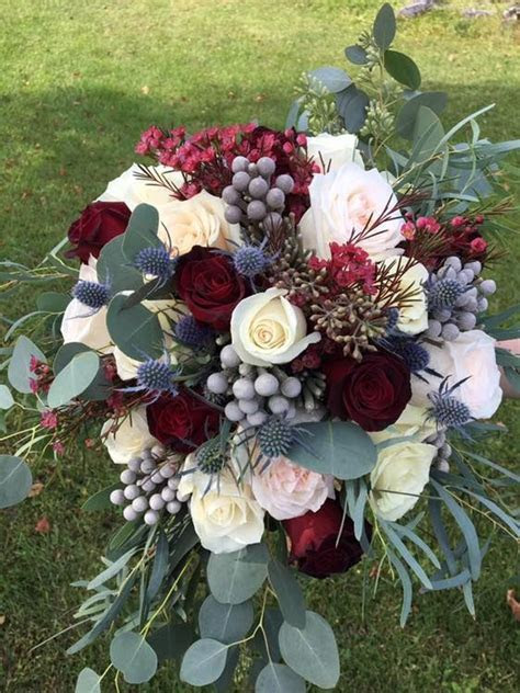 Cascading style bouquet with burgundy wax flower and roses