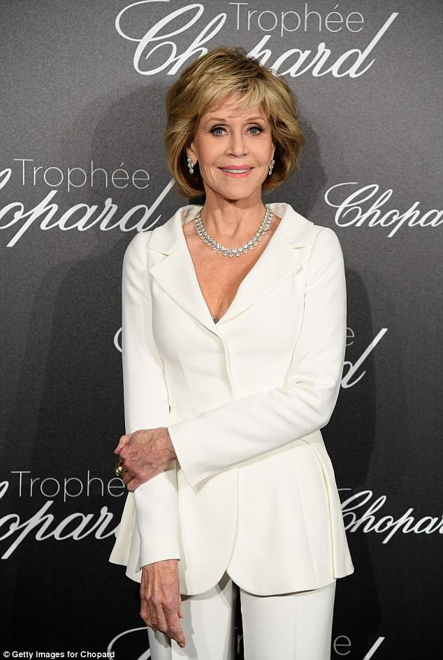 All white everything: Gorgeous Jane Fonda arrived in a smart white suit
