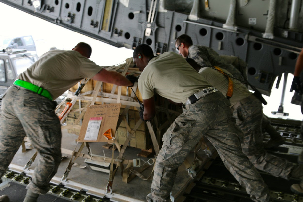 U.S. Air Force personnel unload a C-17 cargo plane at an undisclosed location in the Persian Gulf region.