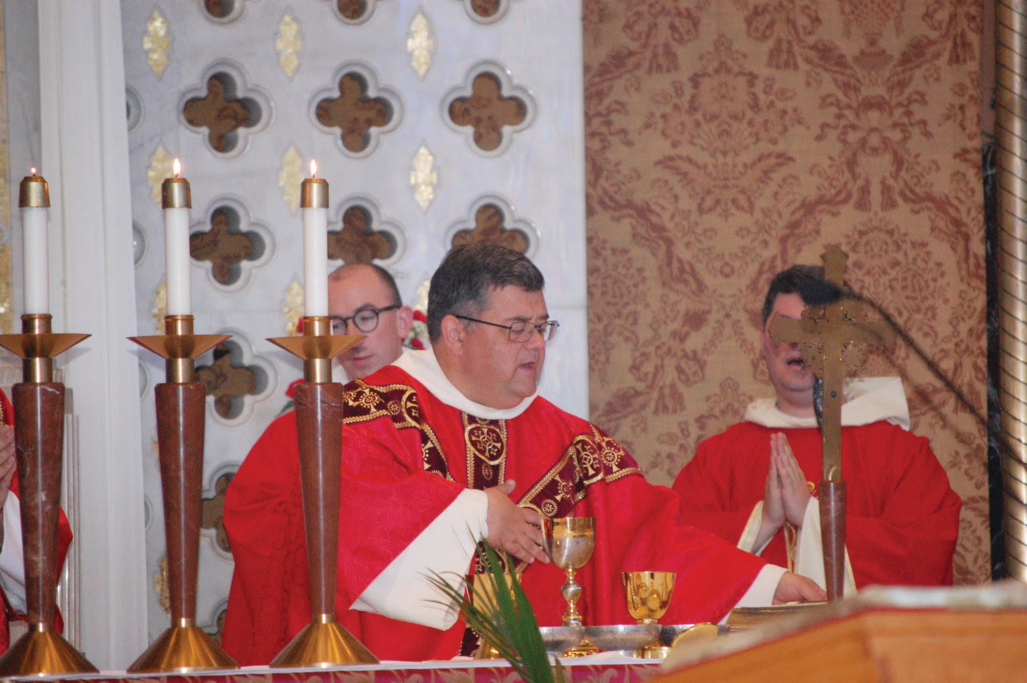 Father James Sullivan, OP, celebrates Mass at the Feast of Pentecost at St. Pius V Church.