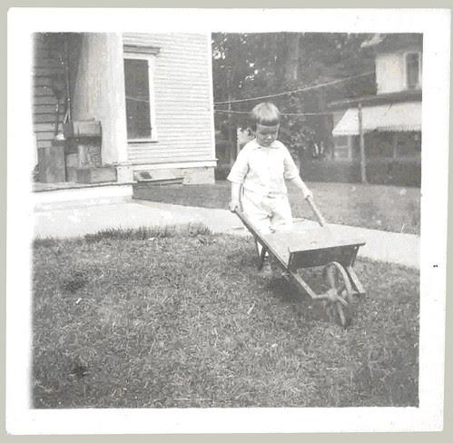 Boy and a wheel barrow