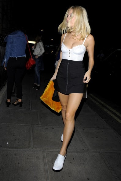 Pixie Lott leaves her hotel with a friend.