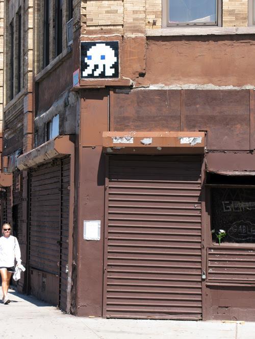 a woman approaches a corner, Manhattan