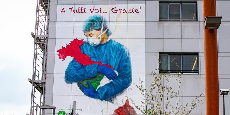 A mural, depicting nurse embracing Italy, posted on the hospital of Pope John XXIII in solidarity with the health workers Coronavirus Outbreak, Bergamo, Italy - 13 Mar 2020, Image: 505963663, License: Rights-managed, Restrictions: , Model Release: no, Credit line: Foto #;Sergio Agazzi / Shutterstock Editorial / Profimedia