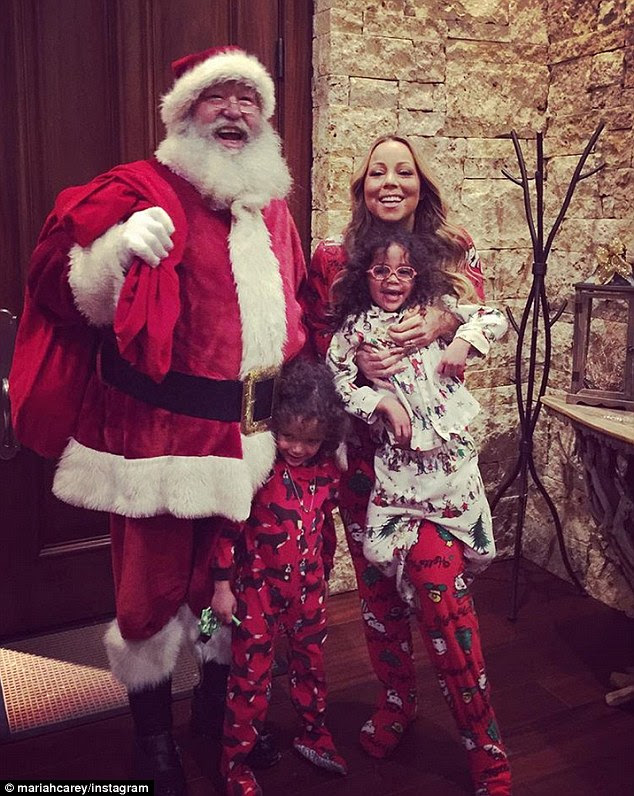 Special visit: The singer and her twinsMonroe and Moroccan got a visit from Santa Claus on Christmas Eve in the ski resort