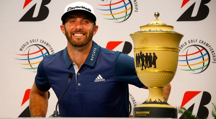DJ with WGC-Bridgestone trophy