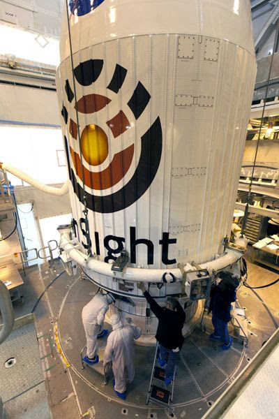 The payload fairing that enshrouds NASA's InSight Mars lander is attached to its Atlas V rocket at Vandenberg Air Force Base's Space Launch Complex 3 in California...on April 23, 2018.