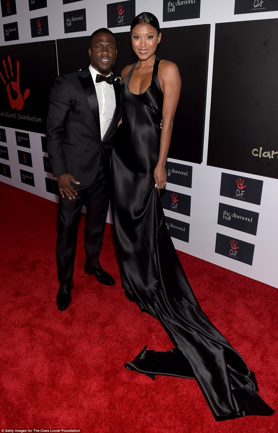 Engaged: Comedian Kevin Hart was accompanied by his finance Eniko Parrish, who looked stunning in a black gown with distressed train