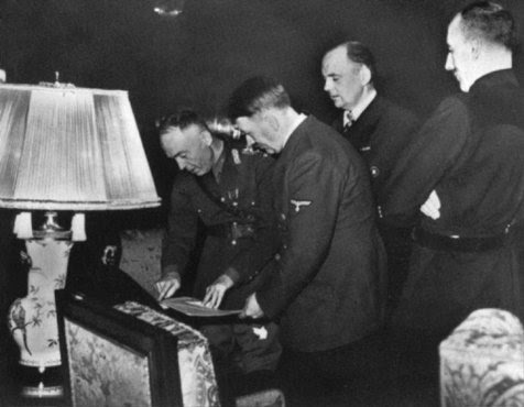 In Hitlers presence, Romanian ruler Ion Antonescu signs the Three-Power Agreement. Berlin, Germany, November 23, 1940.