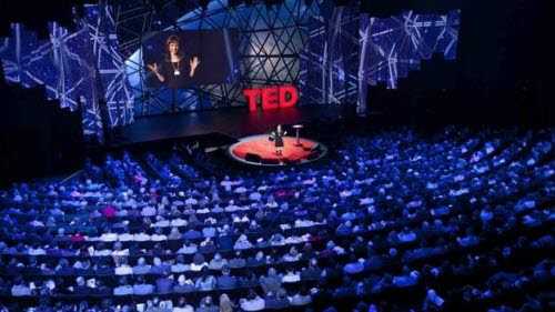 Image of a person giving a TED talk