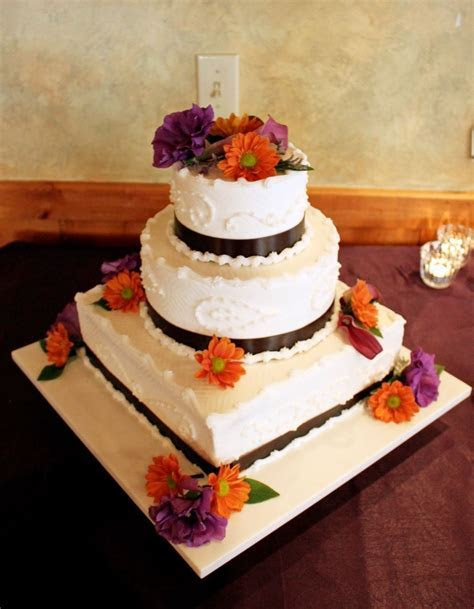 Purple and orange wedding cake   Wedding cakes and flowers