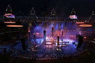 """The Olympic rings are assembled above the stadium in a scene depicting the Industrial Revolution during the London Olympics opening ceremony on July 27. The ceremony was lauded as a """"whimsical, riotous and very British"""" spectacle and an """"obvious retort"""" to the tight discipline seen in Beijing by Australia's press Saturday"""