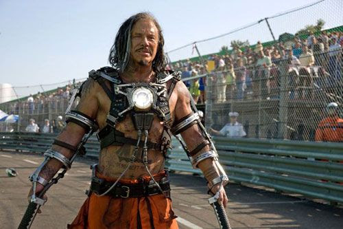 Mickey Rourke sets aside his wrestler outfit to play Whiplash in IRON MAN 2.