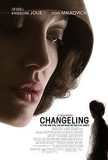 "On a white background , the top left of the poster is dominated by a woman's head looking down on a much smaller silhouette of a child in the bottom right corner. The woman is pale with prominent red lips and is wearing a brown cloche hat. Across the top of the poster are the names ""Angelina Jolie"" and ""John Malkovich"" in uppercase white. Adjacent to the child is the title, ""Changeling"" in uppercase black. Above are the words, ""A true story"" in uppercase red. Underneath is the tagline, in uppercase black: ""To find her son, she did what no-one else dared."""