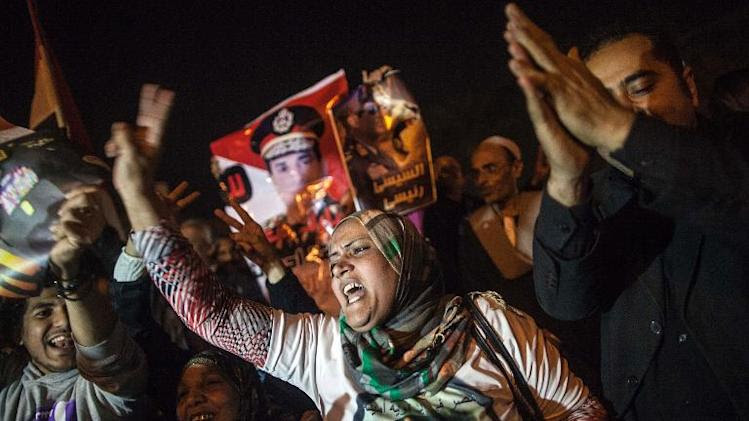 Egyptians celebrate in Tahrir Square, Cairo after a new constitution was approved on January 18, 2014