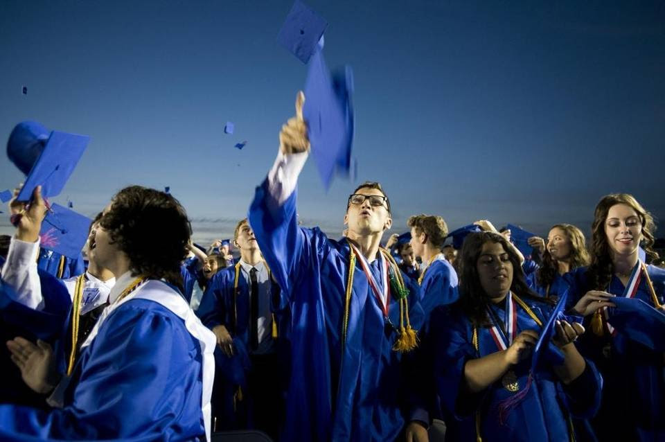 Lukas Novak tosses his hat into the air in celebration at Folsom High School's 2014 graduation ceremony.