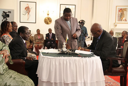 Minister of Finance Patrick Chinamasa being sworn in to a new cabinet post for the Republic of Zimbabwe. The ceremony took place on September 11, 2013. by Pan-African News Wire File Photos