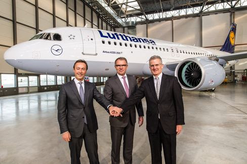 Airbus President and CEO Fabrice Bregier (l-r), Carsten Spohr, Chairman of the Board and CEO of the German Lufthansa AG and Robert Leduc, Pratt & Whitney President, posing in front of an Airbus A320neo for its transfer to Lufthansa at the Airbus factory in Hamburg, Germany, on Jan. 20, 2016.