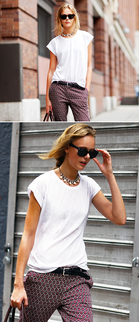 LE FASHION BLOG STREET STYLE FRIDA GUSTAVSSON MODEL OFF DUTY STYLE RAY BAN WAYFARERS EMBELLISHED NECKLACE BASIC WHITE TEE TSHIRT GRAPHIC PRINT PANTS TROUSERS WOVEN BELT LOOSE BRAID PONYTAIL