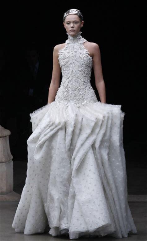 Royal wedding dress designer Sarah Burton's strategic