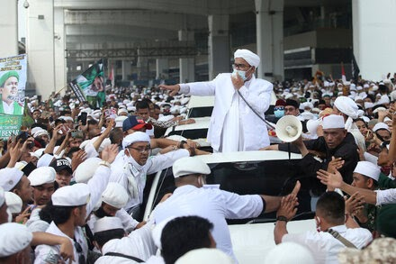 'He Is a Thug': Polarizing Cleric Returns to Indonesia