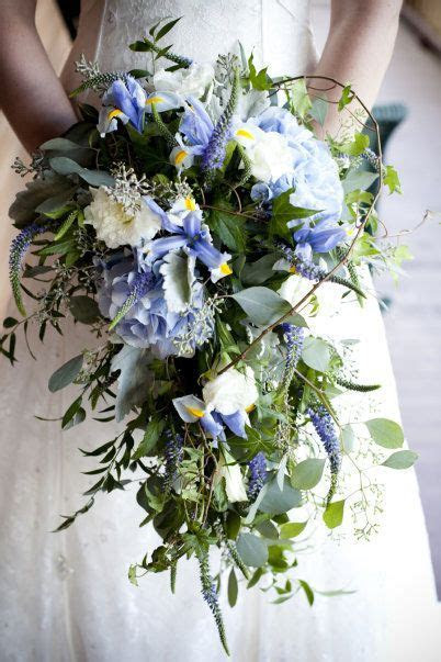 COLOR  blue irises, white lisianthus, purple veronica