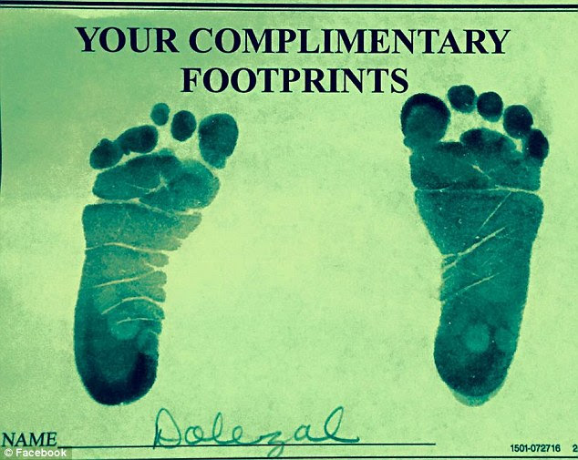 She also shared a photo (above) of the new baby's footprints to Facebook
